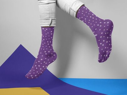Man Jumping While Wearing Socks Mockup on a Multicolor Surface a15600