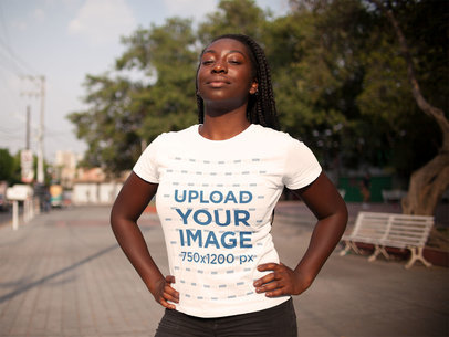 Mockup of a Young Black Woman with Dreadlocks Wearing a Tshirt Mockup While Under the Sun a15941