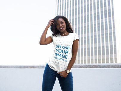 Happy Young Girl Wearing a Round Neck Tee Mockup While Against a City Building a16046