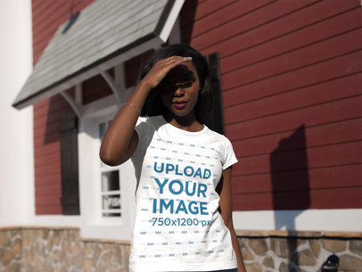 Young Black Woman Wearing a Round Neck Tee Mockup While Walking on a Sunny Day a16052