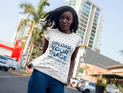 Mockup of a Young Black Girl Wearing a Round Neck Tee While at the City a16067