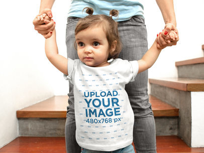 Mockup of a Baby Girl Going Wearing a T-Shirt Walking With The Help of Her Mom a16081