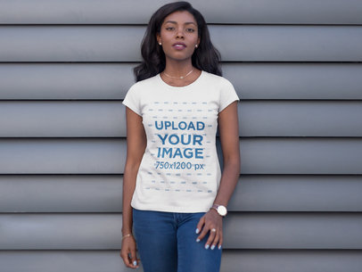 Frontal Shot of a Young Girl Wearing a Round Neck Tee Template While Standing Against a Gray Surface a16060