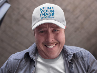 Smiling Middle Aged Dude Wearing a Dad Hat Mockup a15890