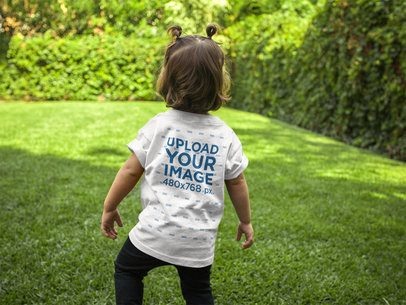 Back of a Little Girl T-Shirt Mockup Standing in the Backyard a16096