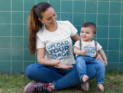 Baby Boy and Mom Wearing Different Round Neck Tees Mockup While Sitting Down Outdoors a16082