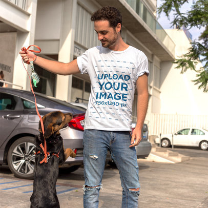 White Guy Playing with a Dog While Wearing a Round Neck T-Shirt Mockup a16190