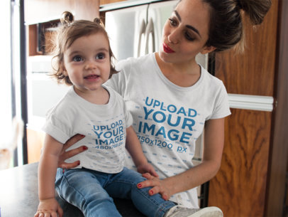 Young Mom with her Baby Girl in the Kitchen Wearing Different Round Neck T-Shirts Mockup 16077