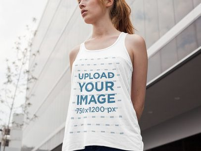 Mockup of a Bella Canvas Tank Being Worn by a Beautiful Girl While in the City a16126