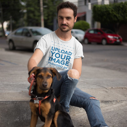 Mockup of a Young White Guy Wearing a Round Neck Tee Mockup While with his Dog a16191