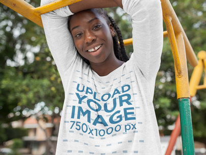 Happy Black Girl with Dreadlocks Wearing a Bella Flowie Long Sleeve Off Shoulder Tee Mockup While in a Park a16207