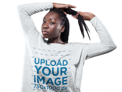 Girl with Dreadlocks Wearing a Bella Canvas Heather Long Sleeve Tee Template While Against a Solid Background a16197