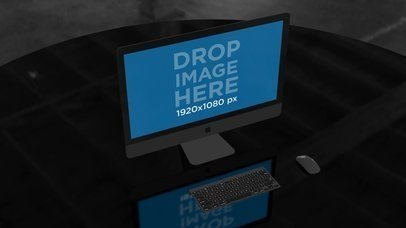 iMac Video Standing on a Table in a Dark Room a16242