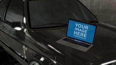 MacBook Pro Video Lying on a Car Hood a16257