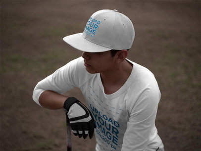 Mockup of a Baseball Batter Wearing a Raglan T-Shirt and a Hat While in the Field a16181