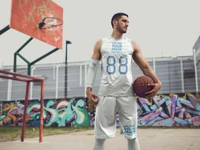 Basketball Jersey Maker - Young Tall Man with Basketball in an Urban Court a16458