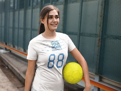 Custom Soccer Jerseys - Smiling Girl Carrying the Ball a16519