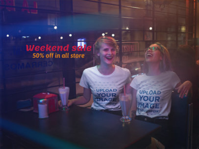 Two Girls Laughing While Wearing Different T-Shirts Mockup at a Restaurant a16431