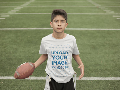Custom Football Jerseys - Kid Holding the Ball at the Field a16476