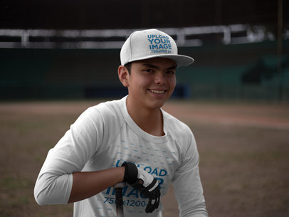 Smiling Hitter Boy Wearing a Baseball Hat Mockup and a Raglan Tshirt at the Field a16180