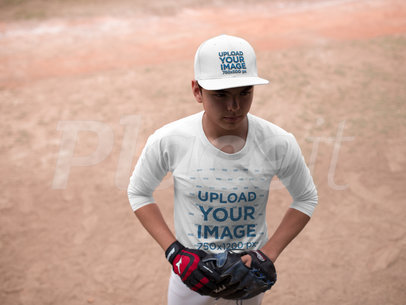 Young Boy Wearing a Baseball Hat Mockup While at the Field a16176