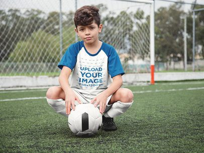 Custom Soccer Jerseys - Little Boy Squatting with the Ball at the Field a16600