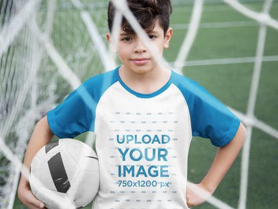 Custom Soccer Jerseys - Little Boy Holding the Ball Near the Net a16599