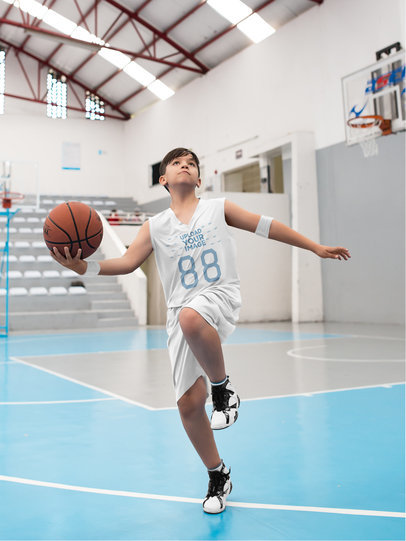 Basketball Jersey Maker - Boy Jumping with the Ball a16625