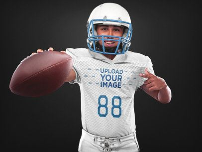 Custom Football Jerseys - Happy Player Showing the Ball a16715