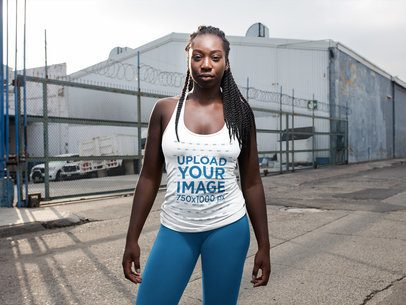 Girl With Dreadlocks Wearing Tank Top Mockup in an Industrial Area a16745