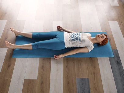 Mockup of a Girl Doing a Shavasana While Wearing Custom Sportswear a16836