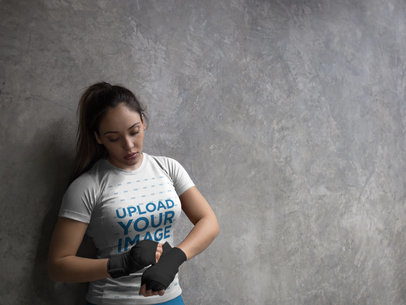 Woman Adjusting her Boxfit Handwraps While Wearing Custom Sportswear Mockup Inside the Locker Room a16845