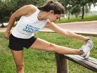Teen Girl Stretching While Wearing Custom Sportswear Mockup at the Park a16850