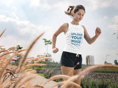 Beautiful Teen Girl Running at a Park While Wearing Custom Sportswear Mockup a16851