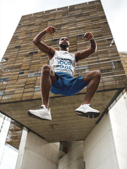 Man Jumping Near a Building While Wearing Custom Sportswear Mockup a16870
