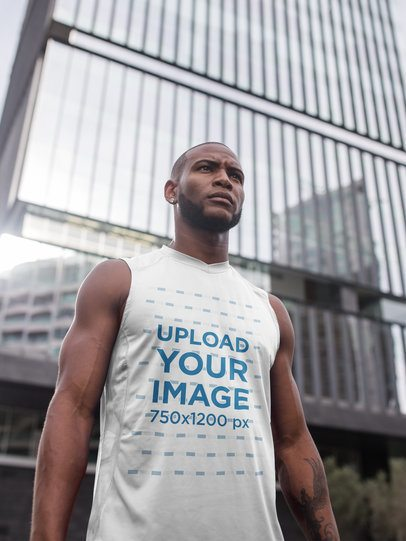 Mockup of a Black Man Standing Against a Building Wearing Custom Sportswear a16869