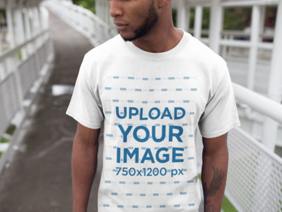 Black Man Walking on a Bridge While Wearing a Round Neck Tee Mockup a16893
