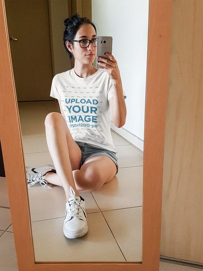 Girl Taking a Mirror Selfie While Wearing a Round Neck Tee Mockup a16924