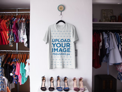 T-Shirt on a Hanger Mockup Inside a Store a16943