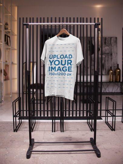 T-Shirt Mockup on a Minimal Rack Indoors a16944