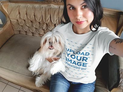 Mockup of a Pretty Woman Wearing a Round Neck Tee While Taking a Selfie with her Dog a17007
