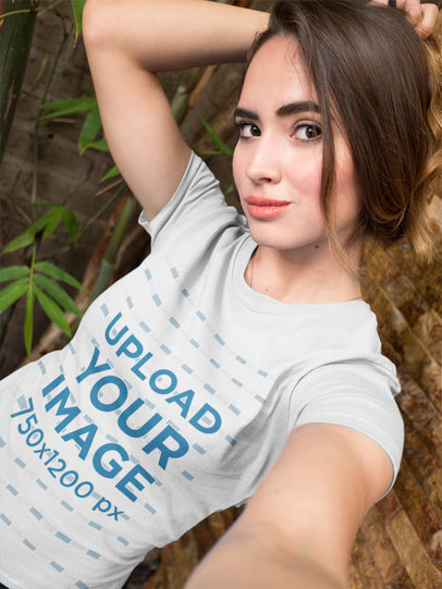 Selfie of a Beautiful Girl Wearing a T-Shirt Mockup While at a Bamboo Garden a17046