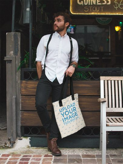 Gentleman Carrying a Tote Bag Mockup While on the Street a17101