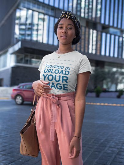 Beautiful Black Girl Wearing a Round Neck T-Shirt Mockup in the City a17123