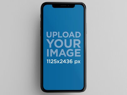 iPhone X Mockup Against a Solid Color Background a17170