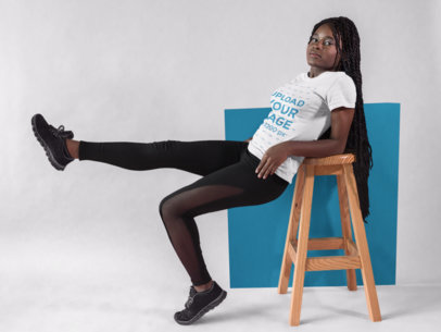 Pretty Girl with Dreadlocks Doing a Pose at the Studio While Wearing a Round Neck Tee Mockup a17184