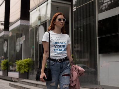 Fashion Girl Wearing a Round Neck Tee Mockup While Walking in the City a17252