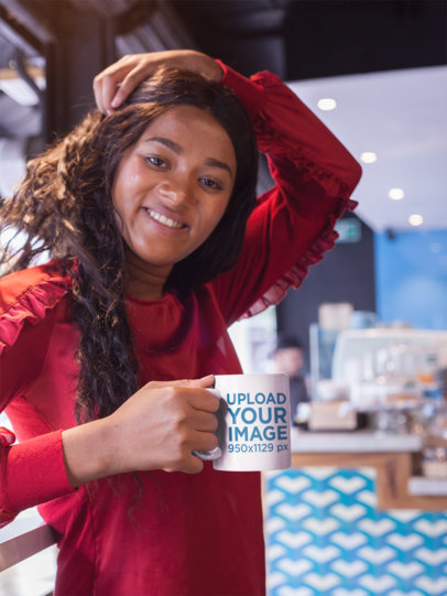 Mockup of a Smiling Beautiful Girl Holding a Coffee Cup While at a Cafe 17341