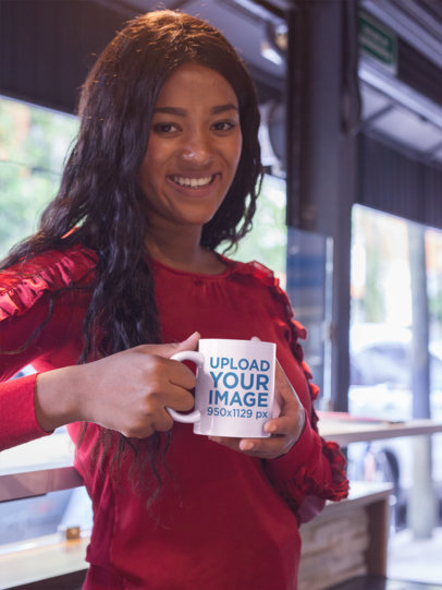 Beautiful Black Girl Holding a Colombian Coffee Cup Mockup While at a Coffee Store a17340
