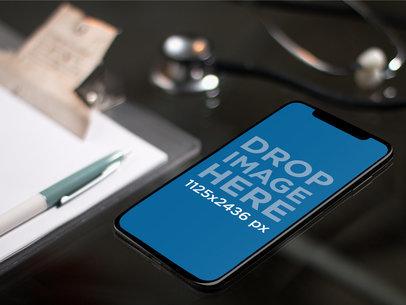 iPhone X Mockup Lying on a Doctors Office Desk a17373